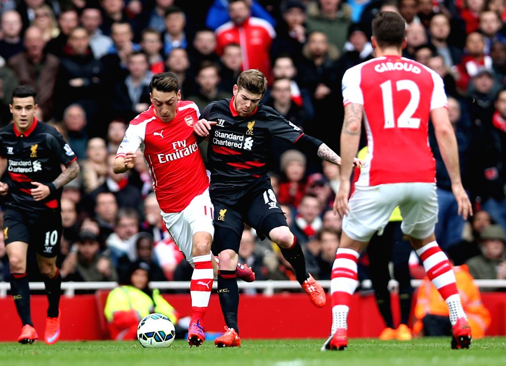 Ozil of Arsenal (2nd L) breaks through during the Barclays Premier League match between Arsenal and Liverpool at the Emirates Stadium in London, England on April 4, ...