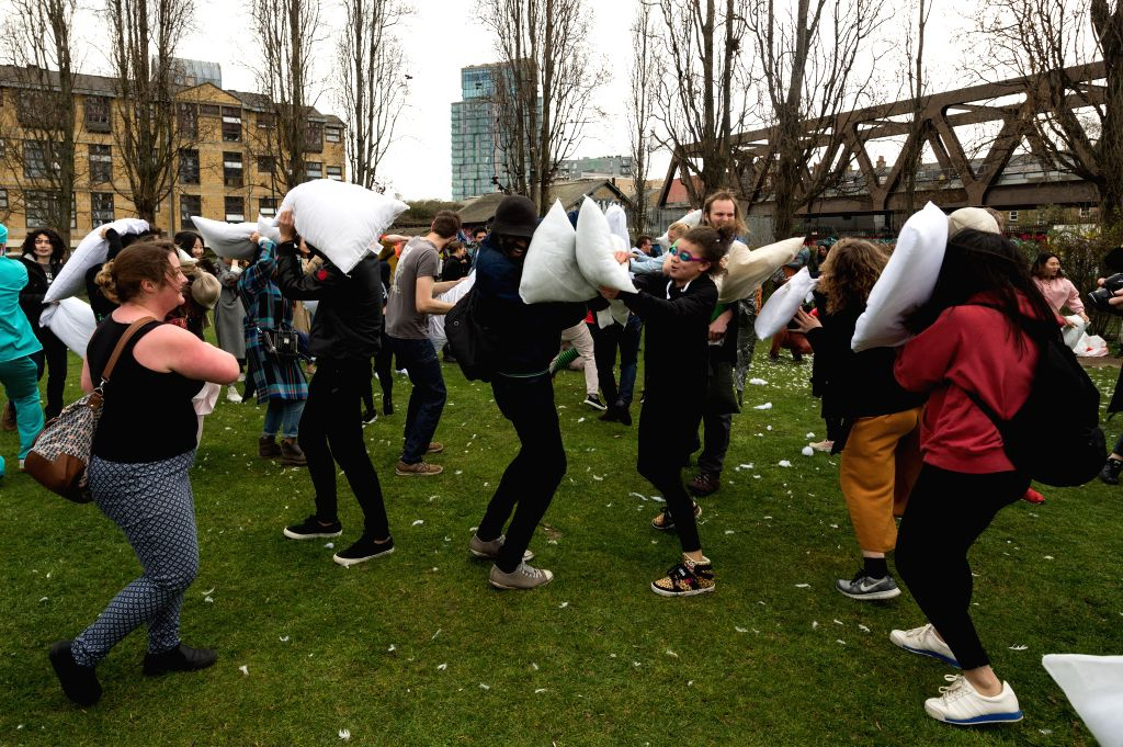LONDON, April 7, 2018 - People have fun taking part in the International Pillow Fight Day 2018 in London, Britain on April 7, 2018.