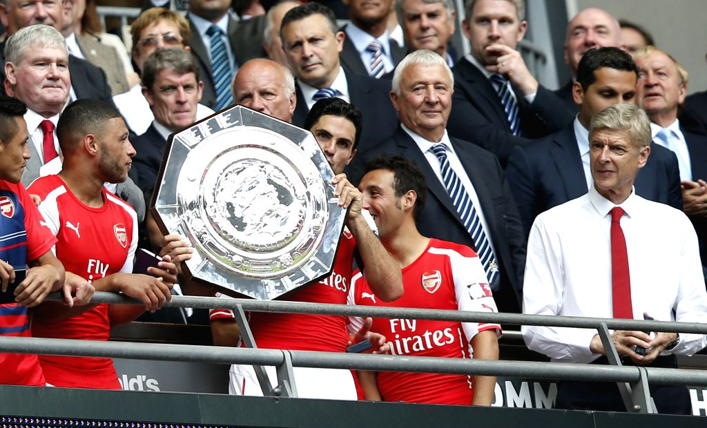 Mikel Arteta(C) of Arsenal kisses the trophy after the Community Shield match between Arsenal and Manchester City at Wembley Stadium in London, Britain on Aug. 10, ..