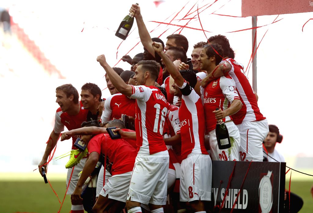 Players of Arsenal celebrate after the Community Shield match between Arsenal and Manchester City at Wembley Stadium in London, Britain on Aug. 10, 2014. Arsenal won