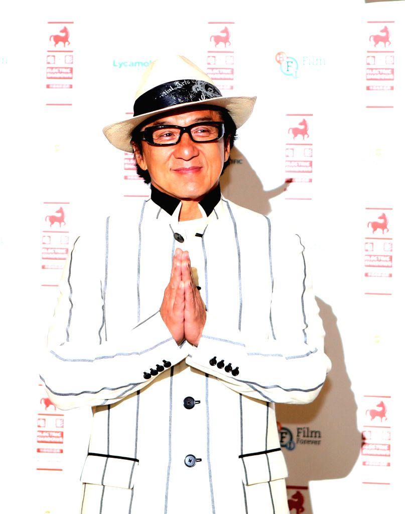 """Actor Jackie Chan attends a photocall to introduce a special screening of """"Chinese Zodiac"""" in London, Britain on Aug. 12, 2014."""
