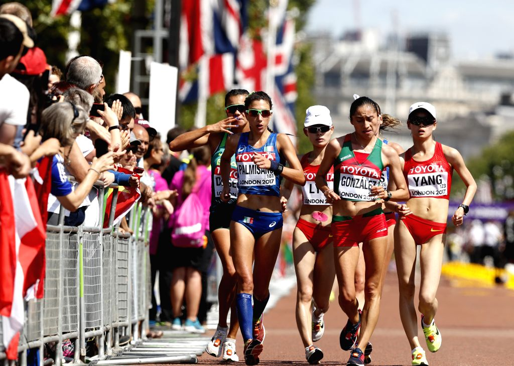 LONDON, Aug. 13, 2017 - Yang Jiayu (1st R) of China competes during Women's 20km Race Walk on Day 10 of the 2017 IAAF World Championships in London, Britain, on Aug. 13, 2017. Yang Jiayu won the gold ...