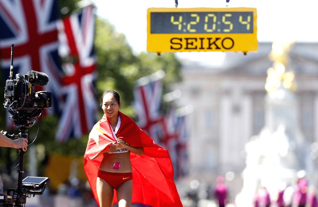 LONDON, Aug. 13, 2017 - Yang Shuqing of China reacts after the women's 50km race walk on Day 10 at the IAAF World Championships 2017 in London, Britain on Aug. 13, 2017.