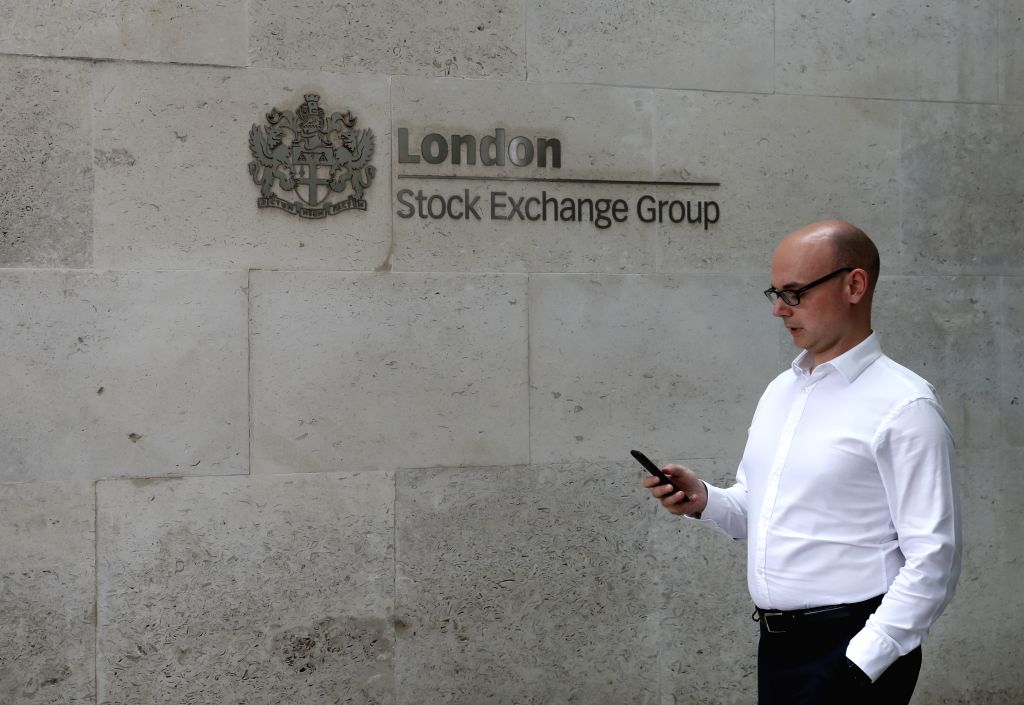 LONDON, Aug. 16, 2019 - A man walks past London Stock Exchange in London, Britain, Aug. 16, 2019. British gross domestic product (GDP) contracted by 0.2 percent in the second quarter (Q2) of 2019 ...