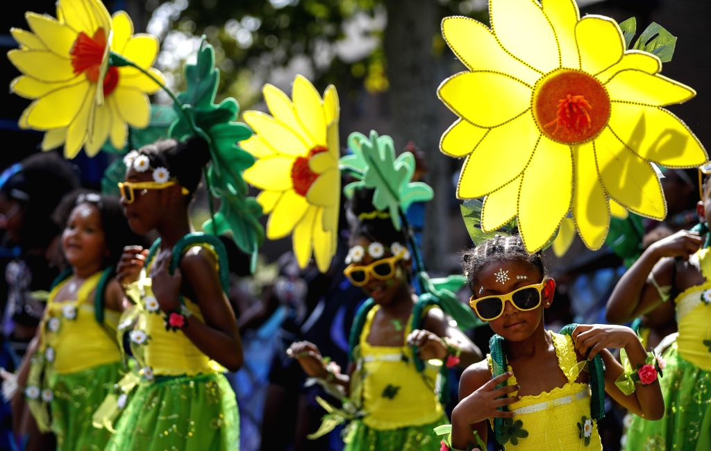 LONDON, Aug. 26, 2019 - Performers participate in the 2019 Notting Hill Carnival Family Day in London, Britain on Aug. 25, 2019. Originated in the 1960s, the carnival is a way for Afro-Caribbean ...
