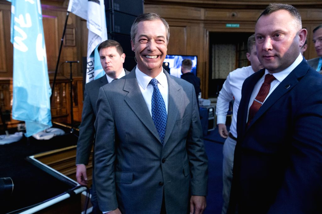 LONDON, Aug. 27, 2019 - Brexit Party leader Nigel Farage (L, front) leaves after making a speech in London, Britain, on Aug. 27, 2019. Nigel Farage said the newly formed Brexit Party plans to contest ... - Johnson
