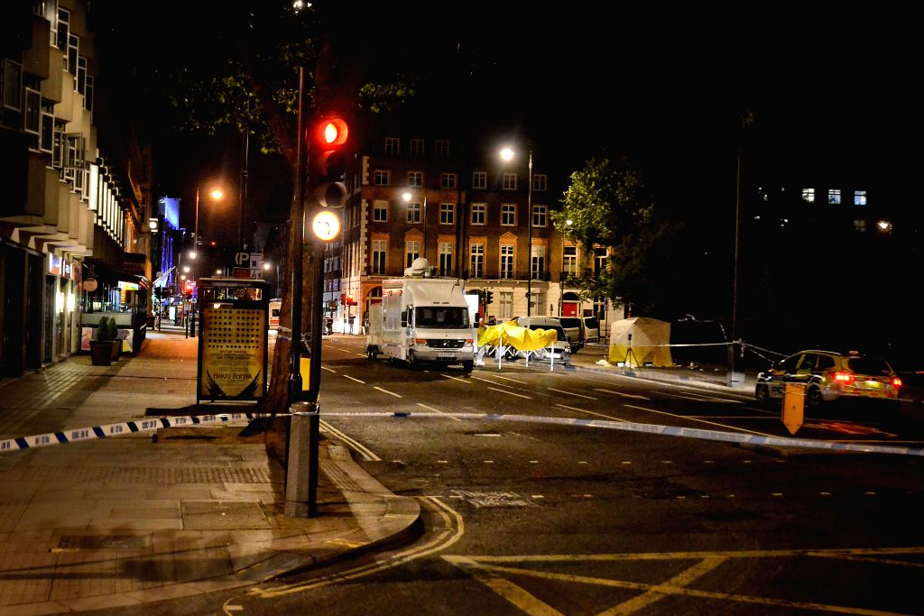 LONDON, Aug. 4, 2016 - Blockade line is seen near the attack site in central Russell Square in London, Britain, Aug. 3, 2016. A woman was killed and five other people were wounded in a knife attack ...