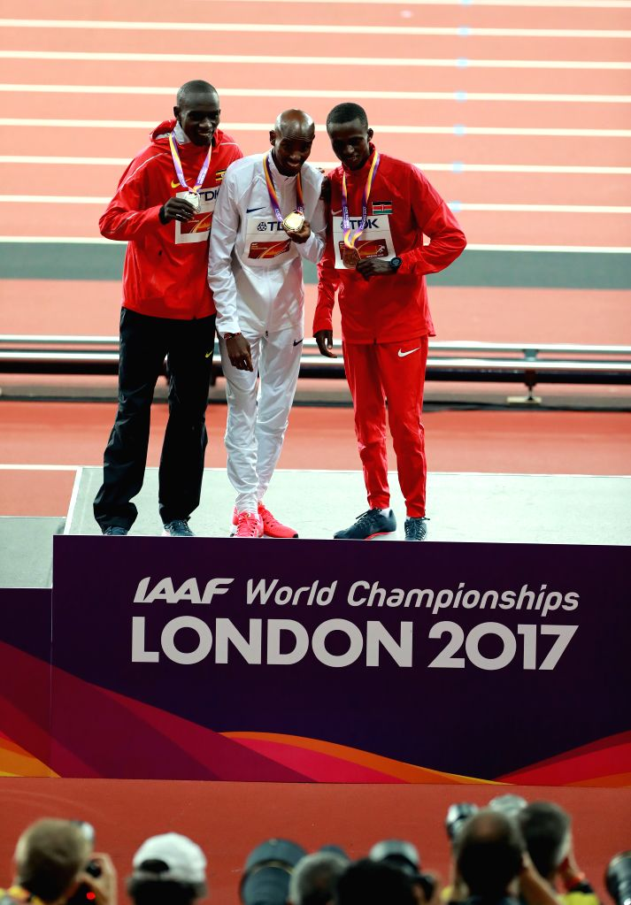LONDON, Aug. 5, 2017 - Gold medalist Britain's Mohamed Farah (C), stands with silver medalist Uganda's Joshua Kiprui Cheptegei (L) and bronze medalist Kenya's Paul Kipngetich Tanui on the podium ...