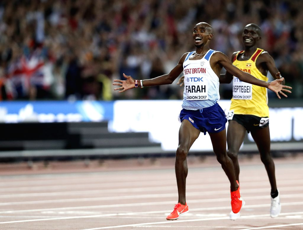 LONDON, Aug. 5, 2017 - Mohamed Farah celebrates (L) after Men's 10,000m final of the 2017 IAAF World Championships in London, Britain, on Aug. 4, 2017. Mohamed Farah claimed the title with 26 minutes ...