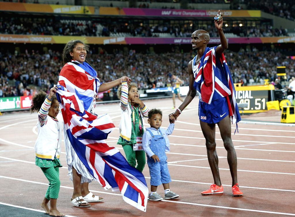 LONDON, Aug. 5, 2017 - Mohamed Farah (R) celebrates with family after Men's 10,000m final of the 2017 IAAF World Championships in London, Britain, on Aug. 4, 2017. Mohamed Farah claimed the title ...