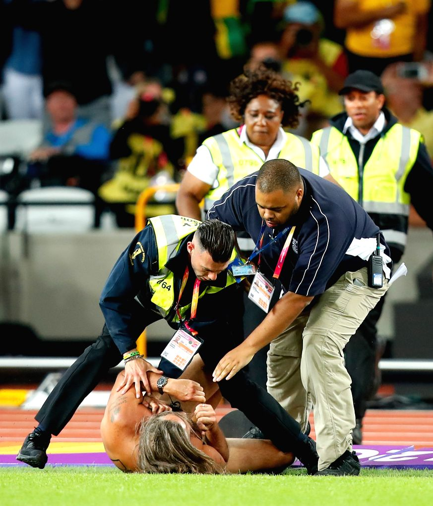 LONDON, Aug. 7, 2017 - Security personnel tackle a pitch invader during the evening session of Day 2 of the 2017 IAAF World Championships at London Stadium in London, Britain, on Aug. 5, 2017.