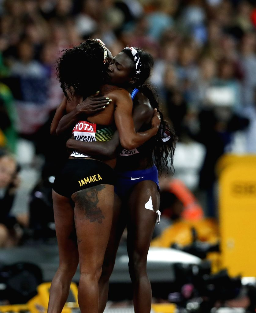 LONDON, Aug. 7, 2017 - Tori Bowie (R) of the United States hugs Elaine Thompson of Jamaica after the women's 100m final on Day 3 at the IAAF World Championships 2017 in London, Britain on Aug. 6, ...