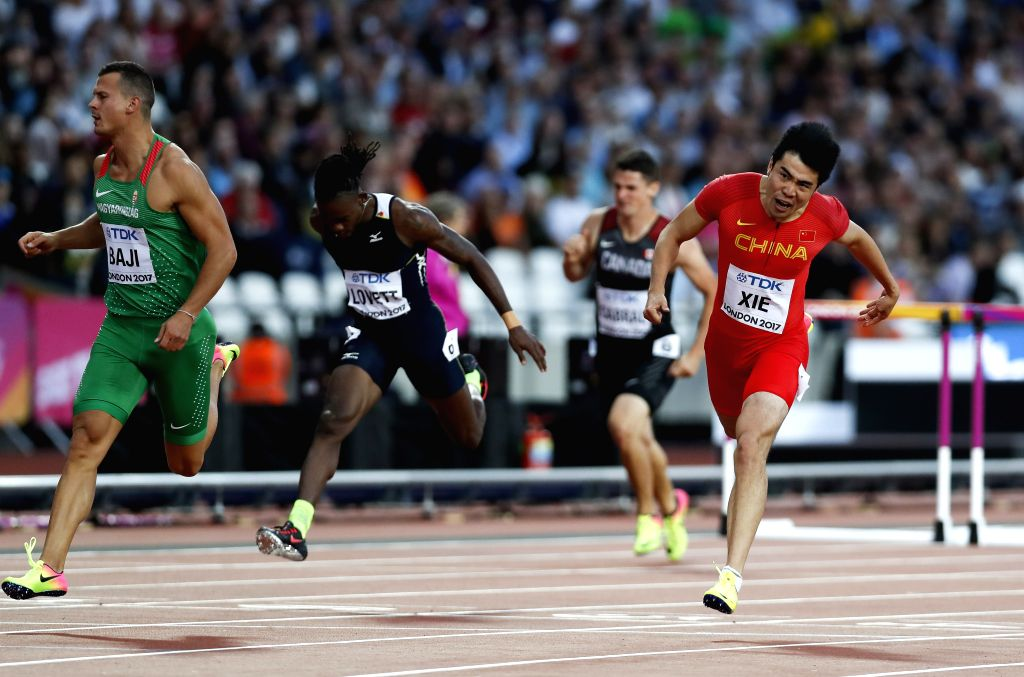 LONDON, Aug. 7, 2017 - Xie Wenjun (1st R) of China competes during the men's 110m hurdles semi-final on Day 3 at the IAAF World Championships 2017 in London, Britain on Aug. 5, 2017.