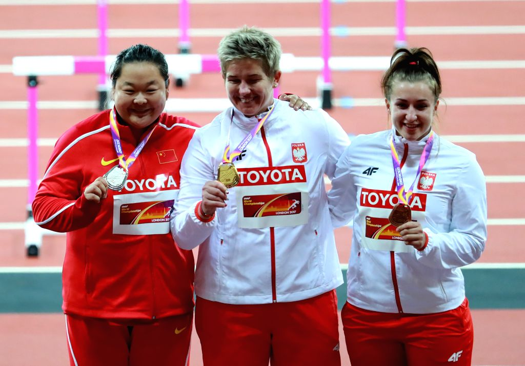 LONDON, Aug. 8, 2017 - Silver medalist Wang Zheng (L) of China poses with Polish Anita Wlodarczyk and Malwina Kopron during the awarding ceremony for Women's Hammer Throw Final on Day 4 of the 2017 ...