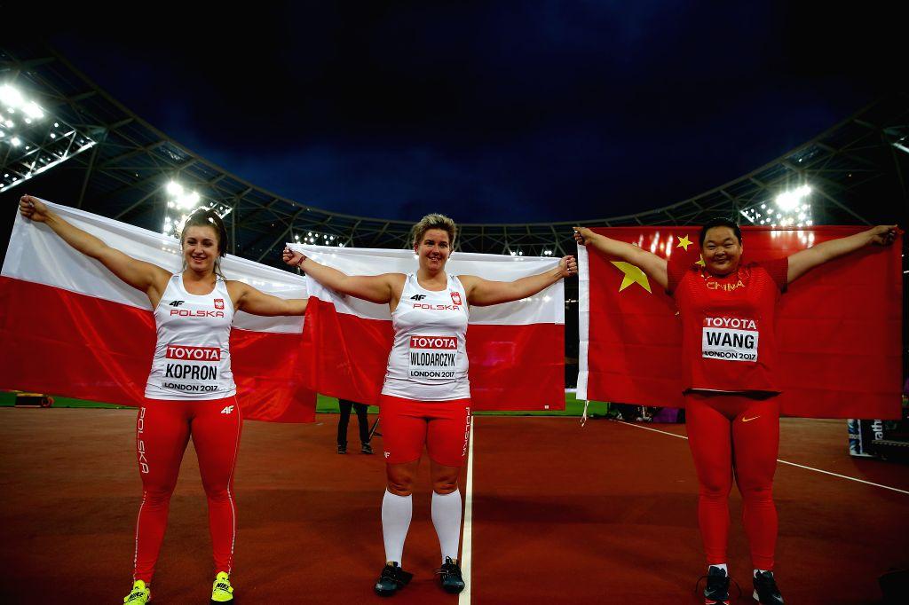 LONDON, Aug. 8, 2017 - Wang Zheng (R) of China celebrates with Polish Anita Wlodarczyk and Malwina Kopron  after Women's Hammer Throw Final on Day 4 of the 2017 IAAF World Championships at London ...