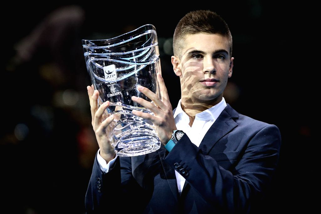 Borna Coric of Croatia poses for pictures after winning the ATP Star of Tomorrow Award in the ATP World Tour Finals in London, Britain, on Nov. 12, 2014.