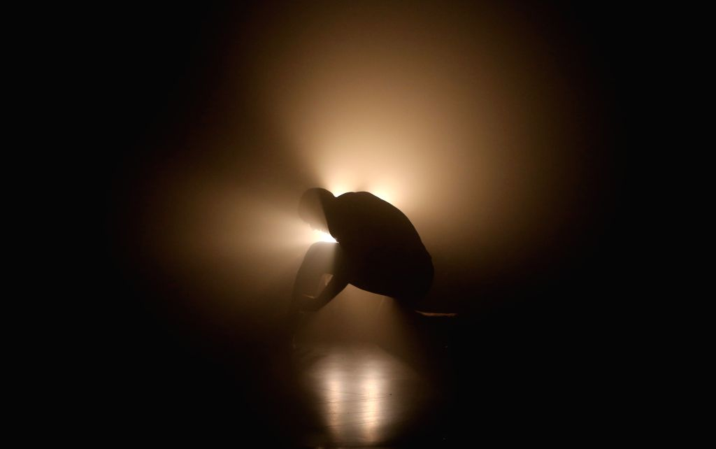 London (Britain): A dancer performs during One Side to the Other, a surreal visual arts exhibition created by the renowned choreographer and dancer Akram Khan at the Lowry Art and Entertainment ...