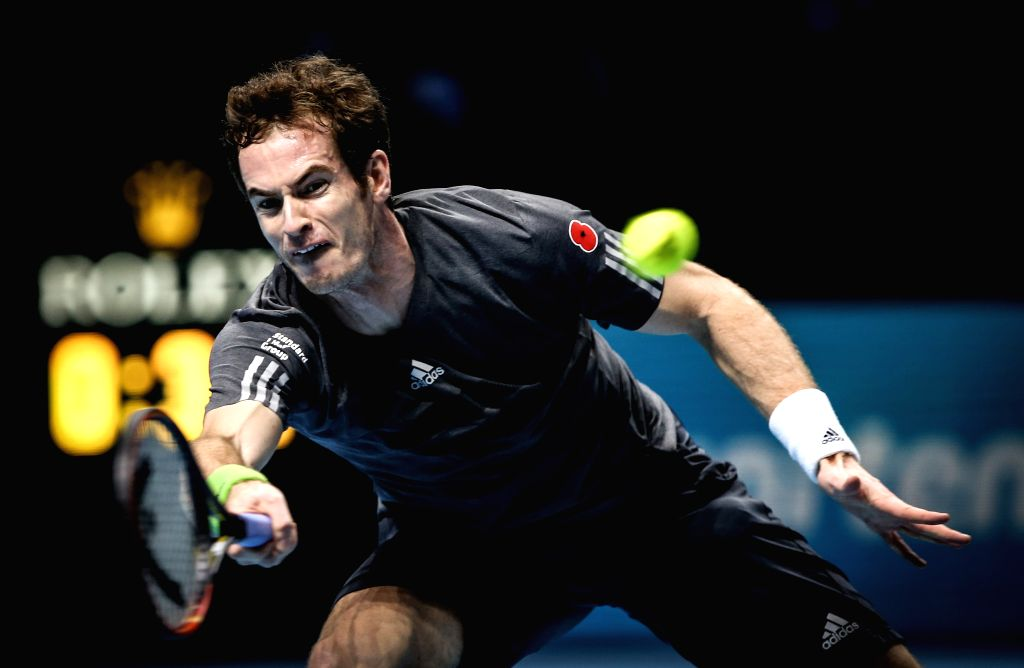 London (Britain): Andy Murray of Britain hits a return during the ATP World Tour Finals round robin match against Roger Federer of Switzerland in London, Britain, on Nov. 13, 2014. Andy Murray was ...