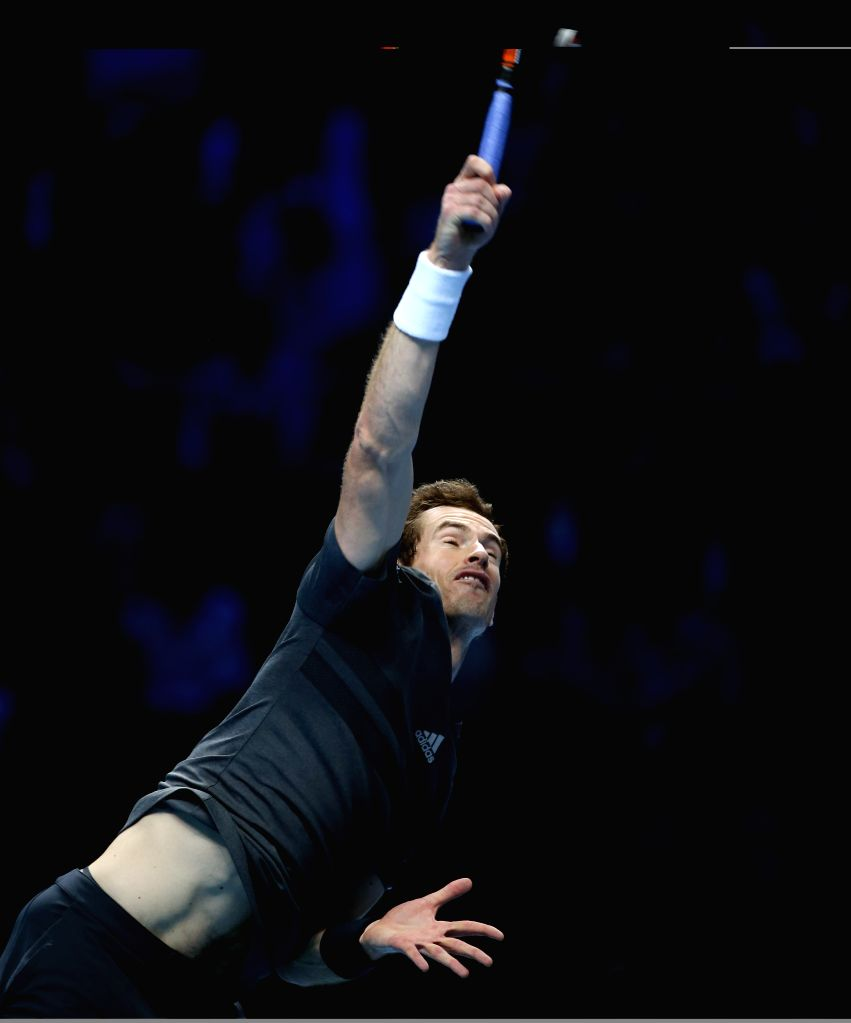 London (Britain): Andy Murray of Britain serves during the ATP World Tour Finals Group match against Milos Raonic of Canada in London, Britain, on Nov. 11, 2014. Andy Murray won 2-0. (Xinhua/Han ...
