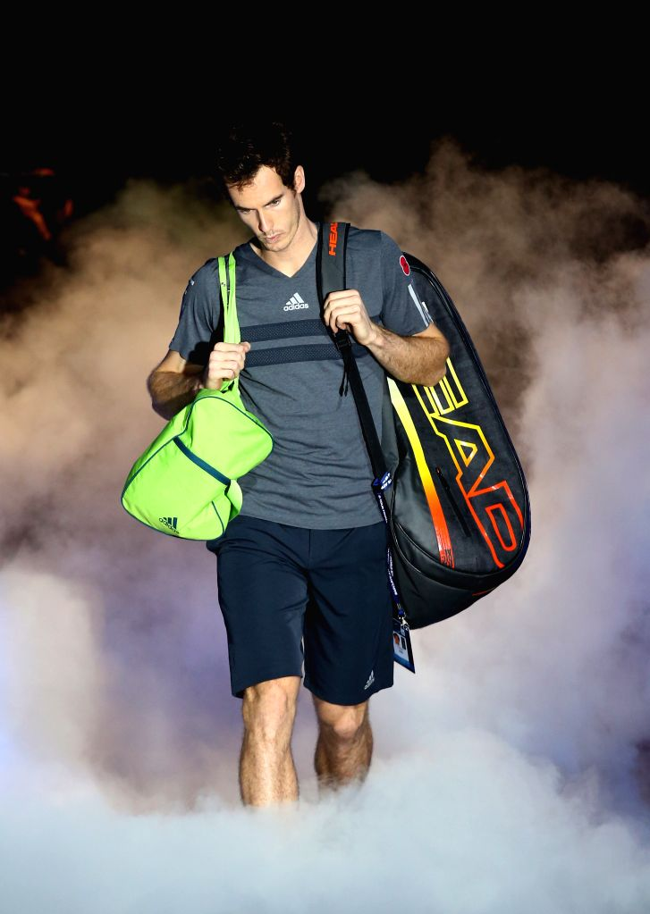 London (Britain): Andy Murray of Britain walks into the court for the ATP World Tour Finals Group match against Milos Raonic of Canada in London, Britain on Nov. 11, 2014. Andy Murray won 2-0. ...
