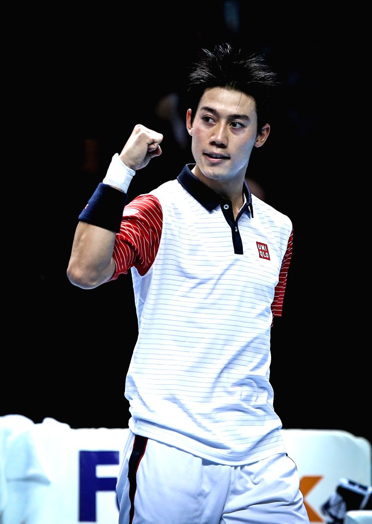London (Britain):Kei Nishikori of Japan celebrates after winning the ATP World Tour Finals Group B match against Andy Murray of Britain in London, Britain, on Nov. 9, 2014. Kei Nishikori won 2-0. ...