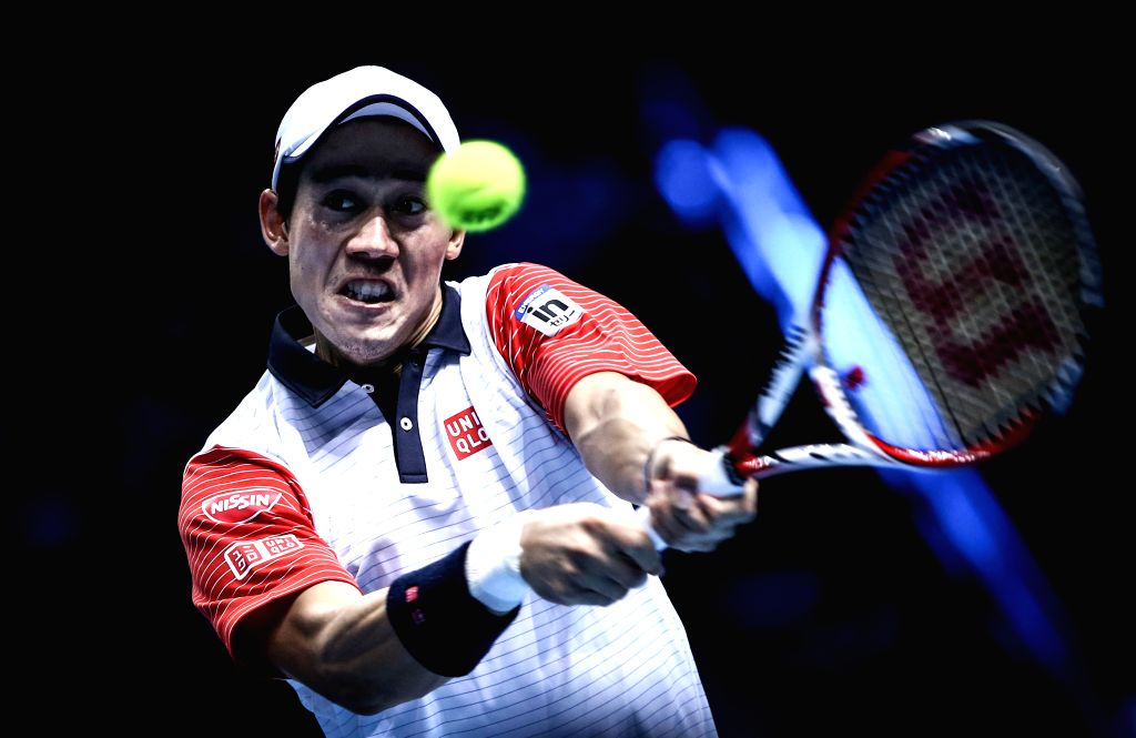 London (Britain):Kei Nishikori of Japan hits a return during the ATP World Tour Finals Group B match against Andy Murray of Britain in London, Britain, on Nov. 9, 2014. Kei Nishikori won 2-0. ...