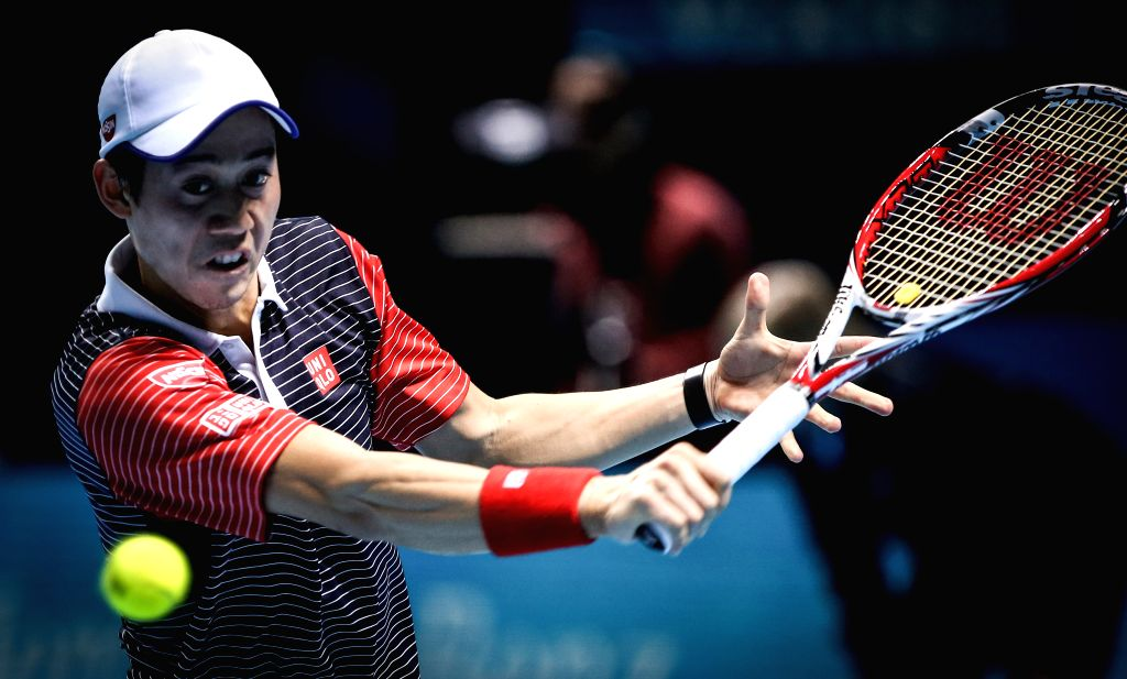 London (Britain): Kei Nishikori of Japan hits a return during the ATP World Tour Finals round robin match against David Ferrer of Spain in London, Britain, on Nov. 13, 2014. Nishikori defeated Ferrer