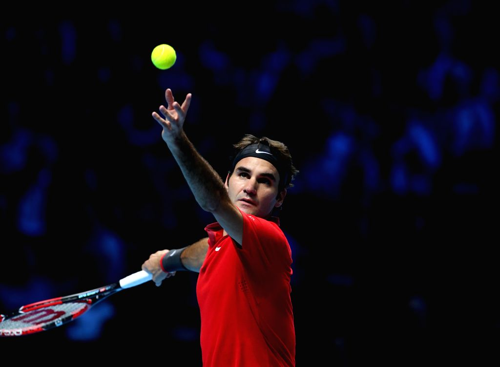 London (Britain): Roger Federer of Switzerland serves during the ATP World Tour Finals Group match against Kei Nishikori of Japan in London, Britain, on Nov. 11, 2014. Federer won 2-0. (Xinhua/Han ...