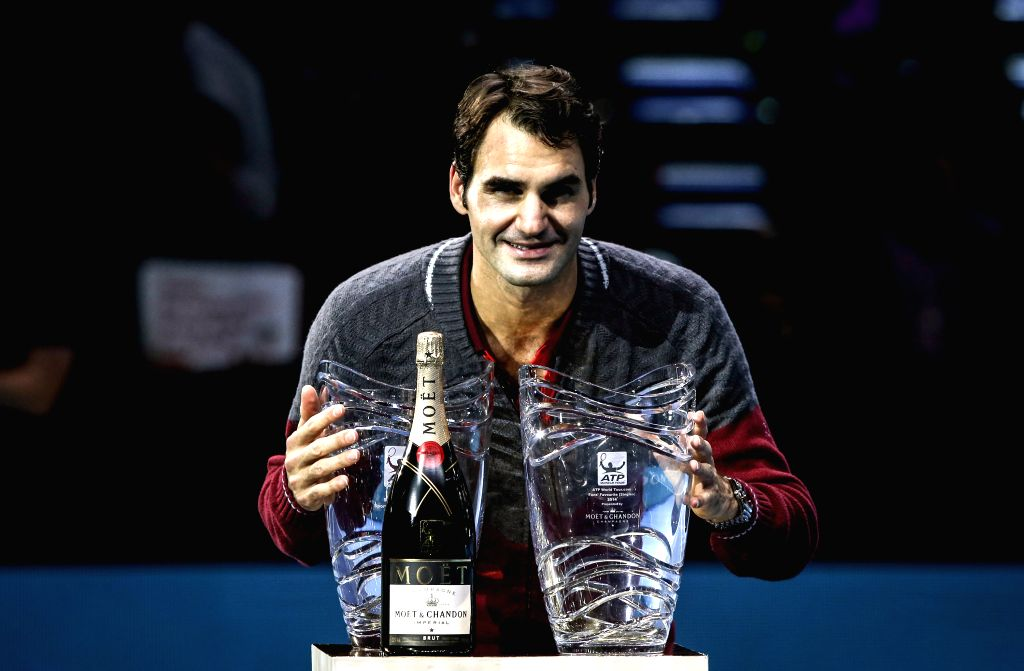London (Britain): Roger Federer of Switzerland poses with the Fans Favourite Award and the Stefan Edberg Sportmanship Award on day one of the ATP World Tour Finals in London, Britain, on Nov. 9, ...