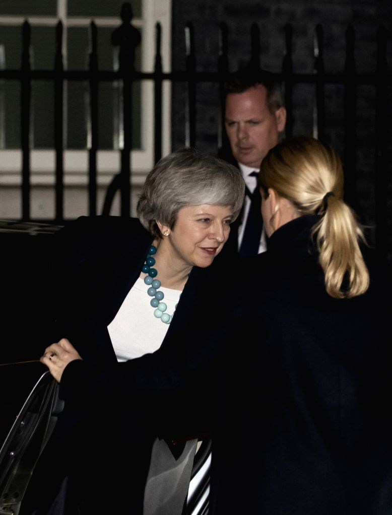 LONDON, Dec. 10, 2018 - British Prime Minister Theresa May (L) arrives at 10 Downing Street after making a statement in the House of Commons, in London, Britain, Dec. 10, 2018. Theresa May on Monday ... - Theresa May