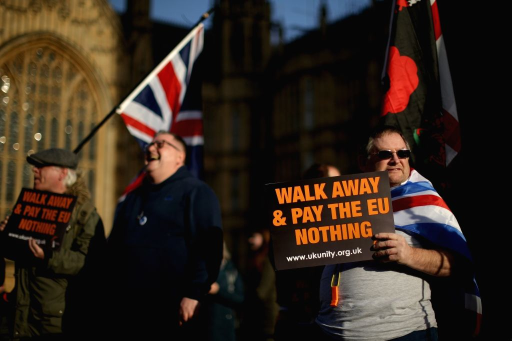 LONDON, Dec. 11, 2018 - Demonstrators stand outside the Houses of Parliament in London, Britain, on Dec. 11, 2018. British Prime Minister Theresa May launched her mission Tuesday to attempt to rescue ... - Theresa May