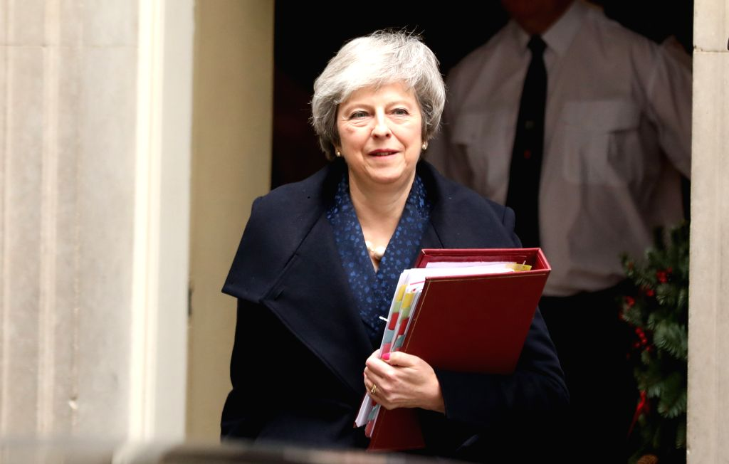 LONDON, Dec. 12, 2018 - British Prime Minister Theresa May leaves Downing Street for Prime Minister's Questions in London, Britain on Dec. 12, 2018. British Prime Minister Theresa May will face a ... - Theresa May