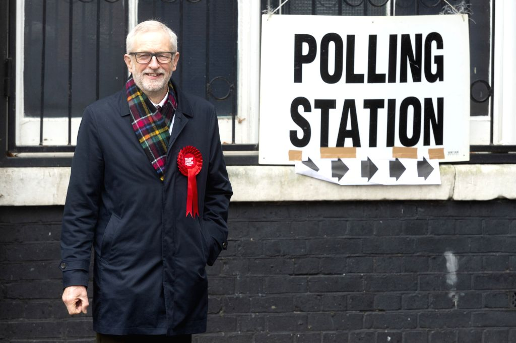 LONDON, Dec. 12, 2019 - British Labour Party er Jeremy Corbyn poses for the media at a polling station after casting his vote for the general election in London, Britain, Dec. 12, 2019. Polling ...