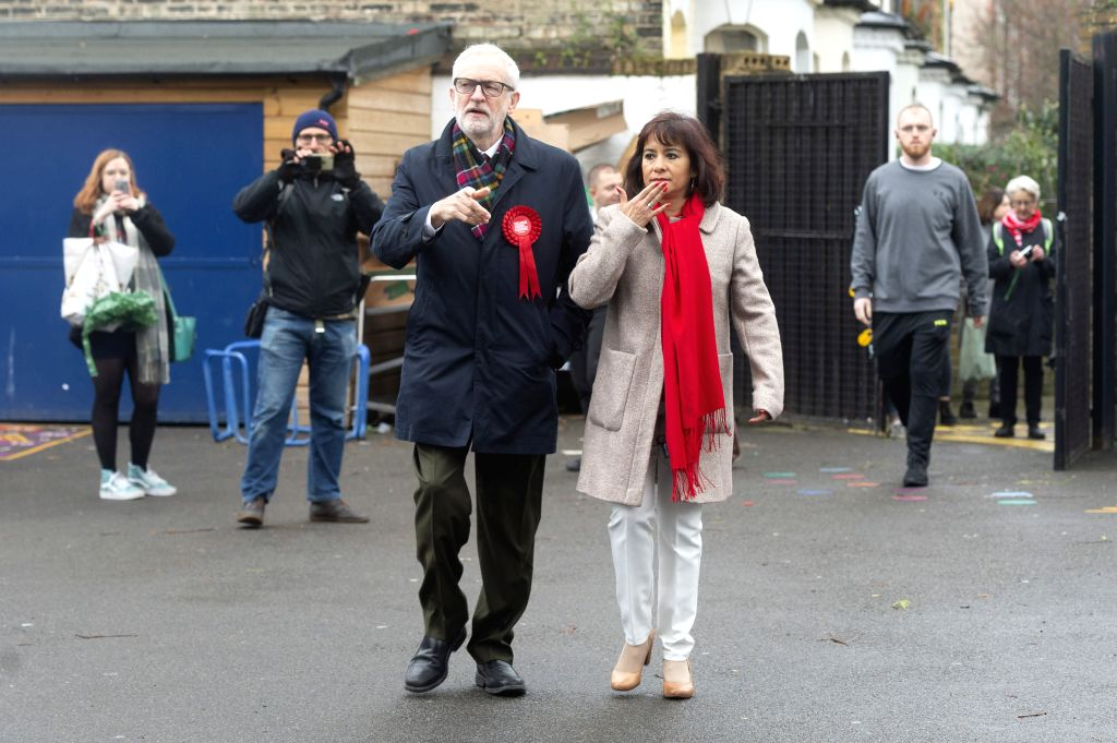 LONDON, Dec. 12, 2019 - British Labour Party er Jeremy Corbyn (L, front) and his wife Laura Alvarez (R, front) arrive at a polling station to cast their votes for the general election in London, ...