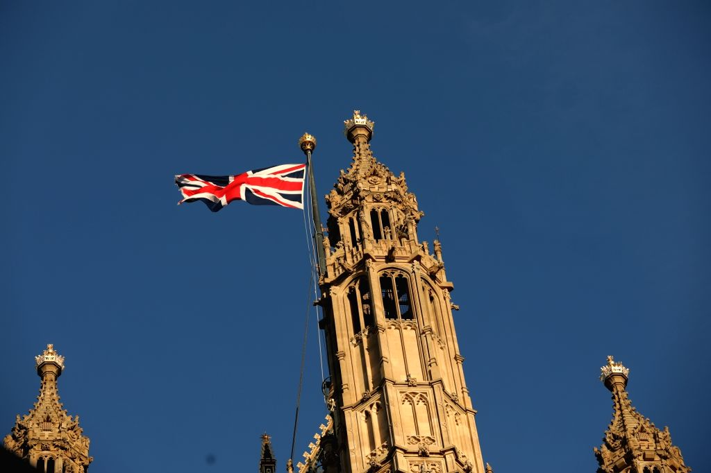LONDON, Dec. 13, 2018 - A Union Jack flag flies at the Houses of Parliament in London, Britain, Dec. 12, 2018. British Prime Minister Theresa May is likely to survive a vote of no confidence late ... - Theresa May