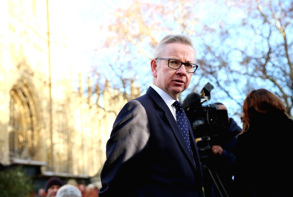LONDON, Dec. 13, 2018 - British Secretary of State for Environment, Food and Rural Affairs Michael Gove speaks to the media outside the Houses of Parliament in London, Britain, Dec. 12, 2018. British ... - Theresa May