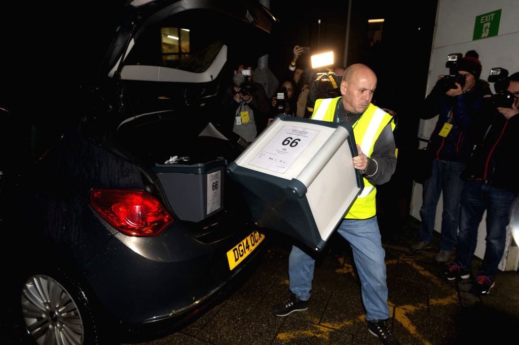 LONDON, Dec. 13, 2019 - A staff member delivers a ballot box for the general election in Uxbridge, London, Britain, Dec. 12, 2019. An exit poll published after voting closed in the British election ...