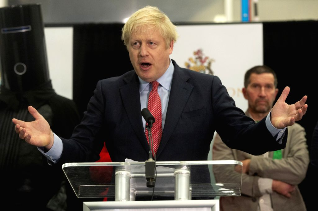 LONDON, Dec. 13, 2019 - British Prime Minister and Conservative Party leader Boris Johnson (C) speaks at the vote declaration in Uxbridge, London, Britain, Dec. 13, 2019. An exit poll published after ...