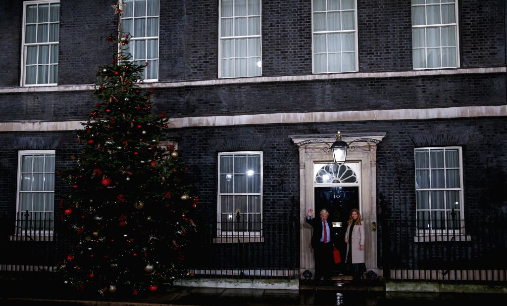 LONDON, Dec. 13, 2019 - British Prime Minister and Conservative Party leader Boris Johnson and his partner Carrie Symonds return to 10 Downing Street in London, Britain, Dec. 13, 2019. An exit poll ...