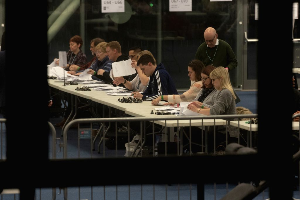 LONDON, Dec. 13, 2019 - Staff count ballots for the general election at Brunel University in Uxbridge, London, Britain, Dec. 12, 2019. An exit poll published after voting closed in the British ...