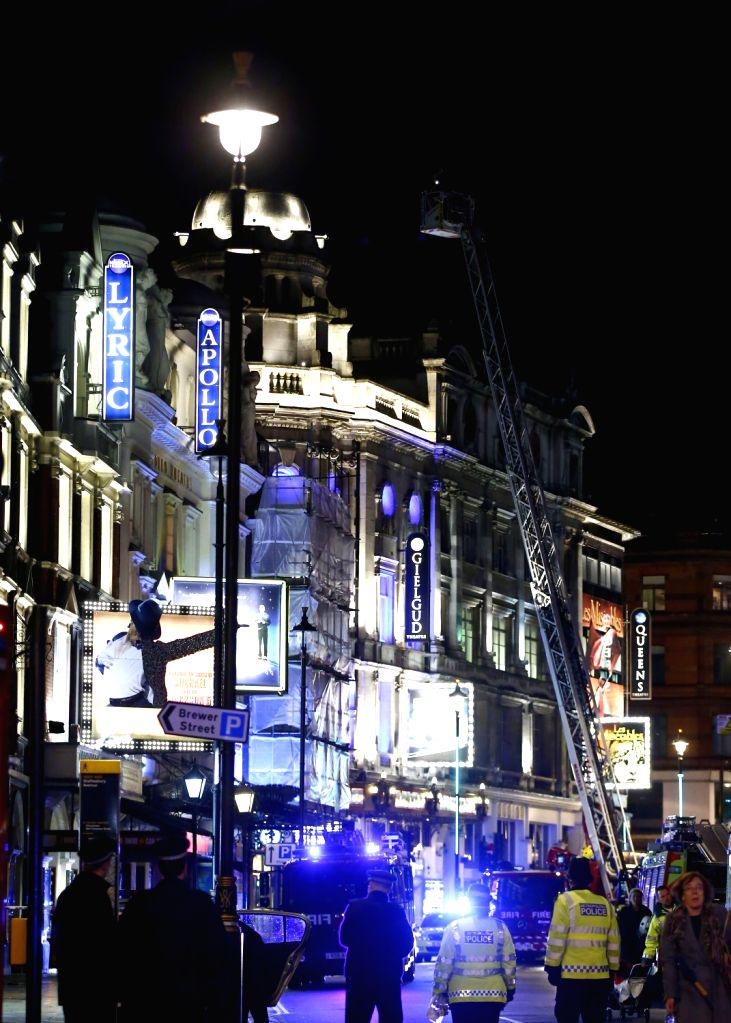 Rescuers work at the site of a roof collapse at a theatre in central London on Dec. 19, 2013. Some 88 people were injured, including 7 serious cases, after part