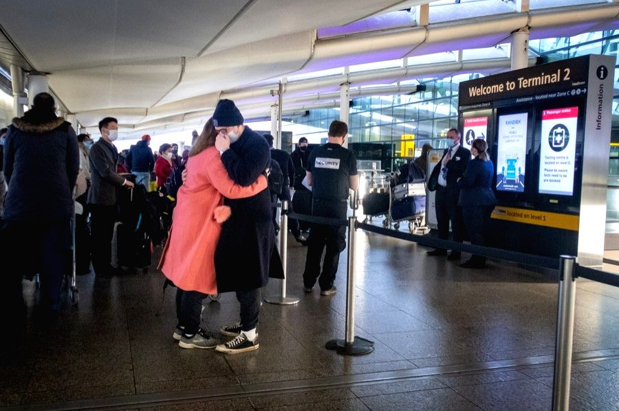 London, Dec. 21 People hug each other goodbye outside the departures area at Heathrow Airport in London, Britain, on Dec. 21, 2020.