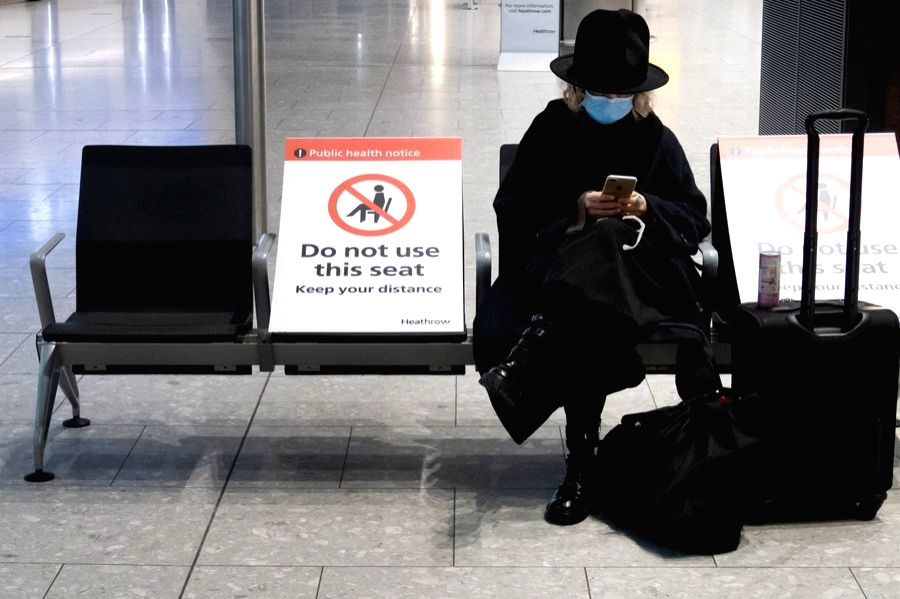 London, Dec. 23 A woman waits in the arrivals hall at Heathrow Airport in London, Britain, on Dec. 21, 2020.