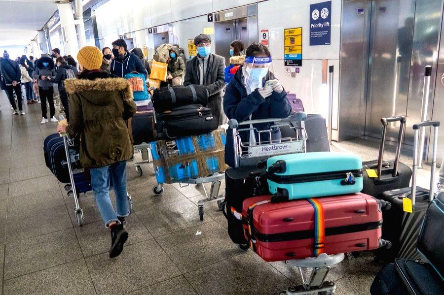 London, Dec. 23 People queue to enter the departures area at Heathrow Airport in London, Britain, on Dec. 21, 2020.