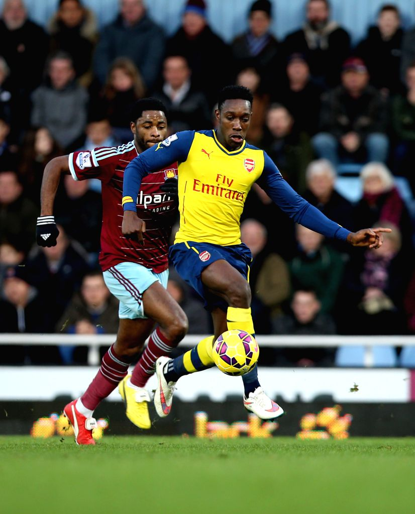 Danny Welbeck (R) of Arsenal vies with Alex Song of West Ham United during the Barclays Premier League match between West Ham United and Arsenal at Upton Park ...
