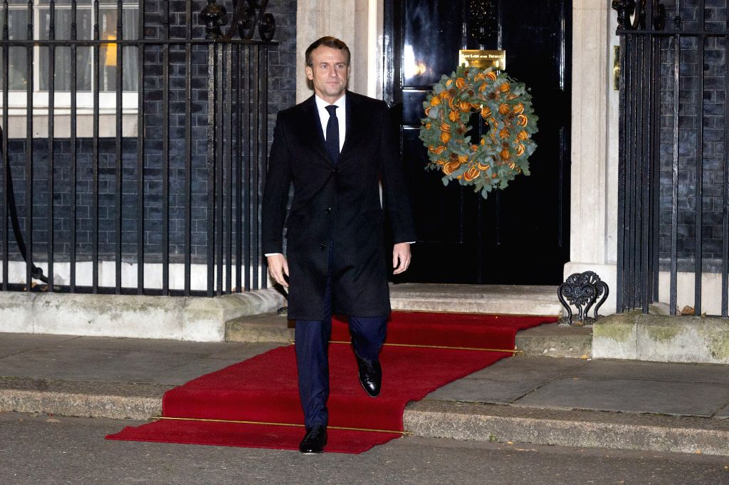 LONDON, Dec. 3, 2019 - French President Emmanuel Macron leaves 10 Downing Street after a meeting with British Prime Minister Boris Johnson, German Chancellor Angela Merkel and Turkish President Recep ... - Boris Johnson