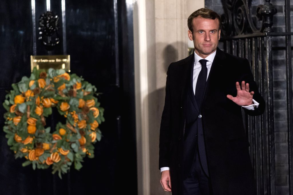 LONDON, Dec. 3, 2019 - French President Emmanuel Macron arrives for a reception at 10 Downing Street in London, Britain, on Dec. 3, 2019.
