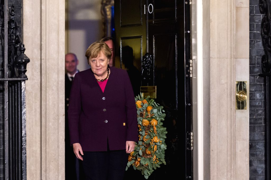 LONDON, Dec. 3, 2019 - German Chancellor Angela Merkel arrives for a reception at 10 Downing Street in London, Britain, on Dec. 3, 2019.