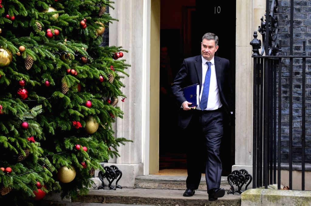 LONDON, Dec. 4, 2018 - British Justice Secretary David Gauke leaves 10 Downing Street after a cabinet meeting in London, Britain on Dec. 4, 2018. British MPs on Tuesday voted by 311 to 293 to find ...