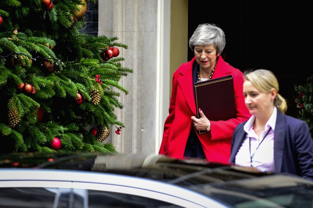 LONDON, Dec. 4, 2018 - British Prime Minister Theresa May (L) leaves 10 Downing Street in London, Britain, on Dec. 4, 2018. British MPs on Tuesday voted by 311 to 293 to find ministers in contempt of ... - Theresa May